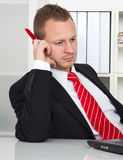 Employee with no desire to work. Lazy businessman on workplace stock photo