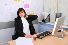 Employee of office. The employee of office with a sick neck Stock Photo