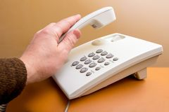 An employee of office takes telephone receiver, an important t royalty free stock images
