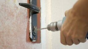 The employee opens the door lock. The employee opens the old door lock stock photography