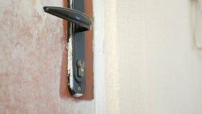 The employee opens the door lock. The employee opens the old door lock royalty free stock photo