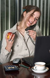 Employee on the phone. Secretary on the phone, with laptop computer Royalty Free Stock Photos