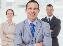 Employee posing with his colleagues on background Stock Photography