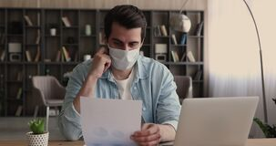 Employee in protective face mask hold document analyzing statistics data