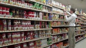 Employee re-stocking shelves