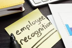 Employee recognition written on a memo stick. Employee recognition handwritten on a memo stick royalty free stock photography