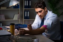 The employee relieving stress from overtime with drugs narcotics. Employee relieving stress from overtime with drugs narcotics stock photography