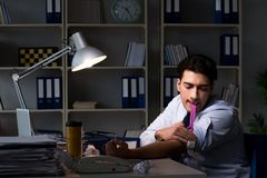 The employee relieving stress from overtime with drugs narcotics. Employee relieving stress from overtime with drugs narcotics stock photos
