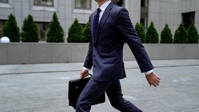 Employee rushing to office center late for important meeting time-management royalty free stock image