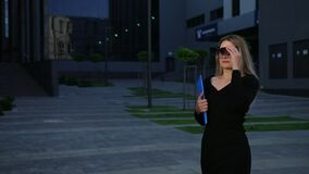 Employee or secretarywalking down street to meet boss, even a businesswoman