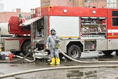 The employee of service of rescue about the fire truck stock photography