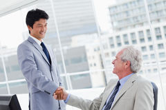 Employee shaking the hand of his manager Stock Photo