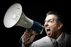 Employee shouting in loudspeaker Stock Photo