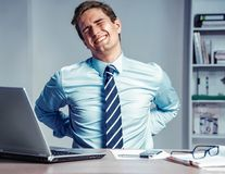 Employee suffers from severe pain in back. Royalty Free Stock Image