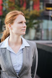 Employee in a Suit among Office Buildings Royalty Free Stock Images