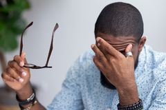 Free Employee Taking Off Glasses Touching Massaging Eyes Royalty Free Stock Photo - 133948705