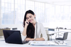 Employee talking on the mobile phone in office Royalty Free Stock Photo