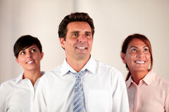 Employee team smiling and looking at people Royalty Free Stock Photos