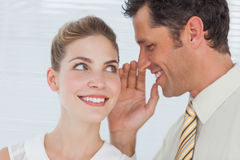Employee telling secret to his colleague Royalty Free Stock Image