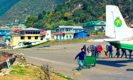 Employee of Tenzing-Hillary airport serve aircraft of Tara Air - famous nepalese airline provider. Lukla, Nepal royalty free stock photo