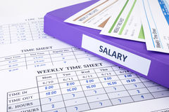 Employee time sheet and salary binder Royalty Free Stock Images