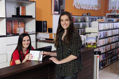 Employee at the video rental store Stock Photography