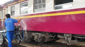 An employee washes a railway passenger car stock video footage