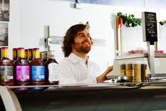 Employee weighing meat in butcher shop Stock Photography