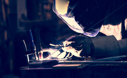 Employee welding aluminum using TIG Royalty Free Stock Photos