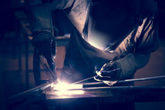 Employee welding aluminum using TIG Stock Photography