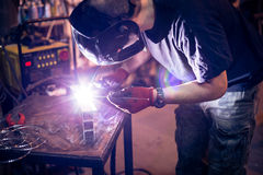Employee welding aluminum using TIG Stock Image