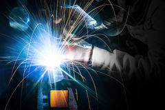 Employee welding steel in industry. Royalty Free Stock Images