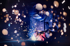 Employee welding steel with sparks using mig mag welder Royalty Free Stock Photos