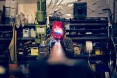 Employee welding steel with sparks using mig mag welder Stock Photo