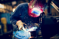 Employee welding steel with sparks using mig mag welder Stock Photography