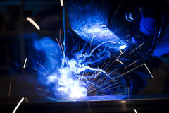 Employee welding using MIG/MAG. Stock Photography