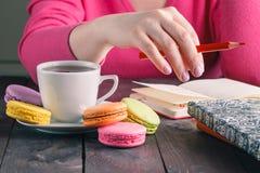 Employee woman drinking morning tea of coffee Stock Photos