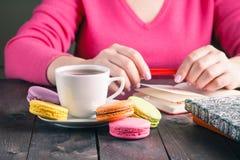 Employee woman drinking morning tea of coffee Royalty Free Stock Photos