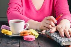 Employee woman drinking morning tea of coffee Royalty Free Stock Image