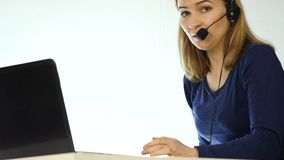 Employee working in a call center. Headset telemarketing woman talking on helpline. slow motion stock video footage