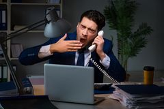 The employee working late to finish important deliverable task Stock Image