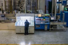 Employee Working at Printing Equipment Factory Industrial Settin. G stock photography