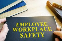 Employee Workplace Safety guide. Employee Workplace Safety guide on a table stock photos