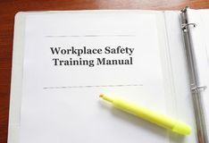 Workplace Safety Training Manual. Employee Workplace Safety Training Manual on a desk with highlighter royalty free stock images