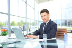 Employee works with documents in a spacious office  glass Royalty Free Stock Photo