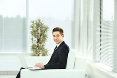 Employee works with documents in a spacious office  glass Royalty Free Stock Images