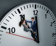 Woman and Man are fighting for more time royalty free stock photography