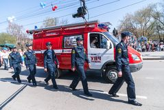 Employees and car of fire department on parade Royalty Free Stock Image
