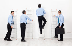 Employees climbing the corporate ladders Royalty Free Stock Photos