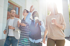 Employees with coffee Royalty Free Stock Image